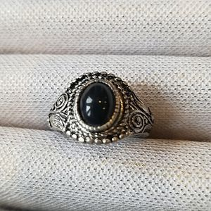 Black stone set in silver